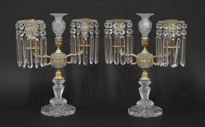 Lot 27-A pair of cut-glass and gilt metal candelabra