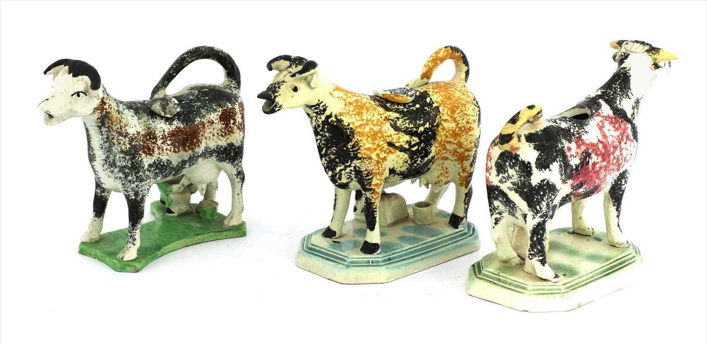 Lot 13-Three Staffordshire cow creamers
