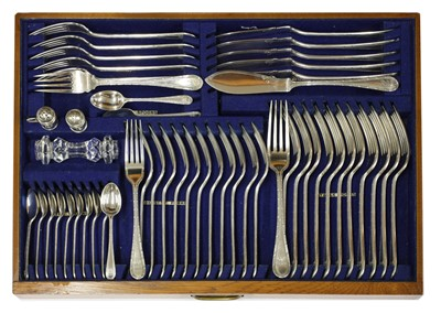 Lot 50-A comprehensive George V silver twelve-setting canteen of cutlery