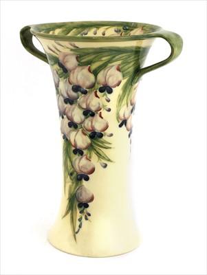 Lot 54 - A William Moorcroft Macintyre twin-handled 'Wisteria' vase
