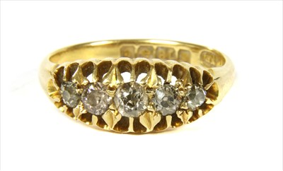 Lot 5-An 18ct gold boat shaped five stone diamond ring