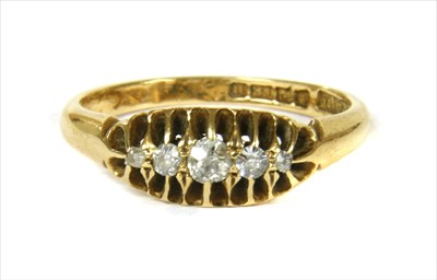 Lot 4-An 18ct gold boat shaped five stone diamond ring