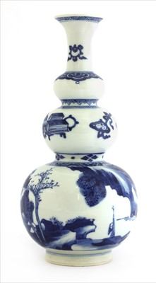 Lot 7 - A Chinese blue and white triple gourd vase