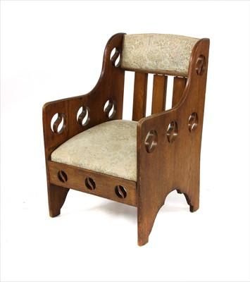 Lot 68 - An Arts & Crafts oak armchair