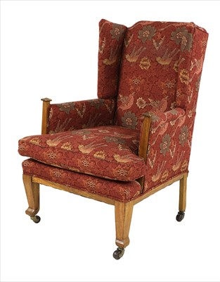 Lot 90 - An Arts & Crafts oak wing back armchair