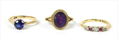 Lot 23-A gold diamond and ruby five stone ring