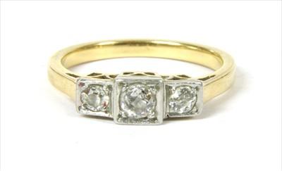 Lot 10-A gold three stone diamond ring