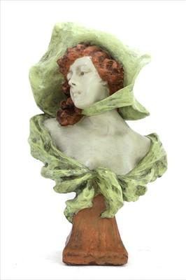 Lot 33-An Art Nouveau painted bust of a lady