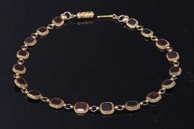 Lot 8-A gold garnet set rivière necklace