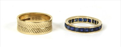 Lot 24-A gold sapphire full eternity ring
