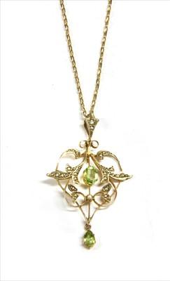 Lot 20-An Edwardian gold peridot and split pearl pendant