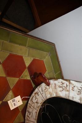Lot 15-A mahogany and tile top hexagonal table