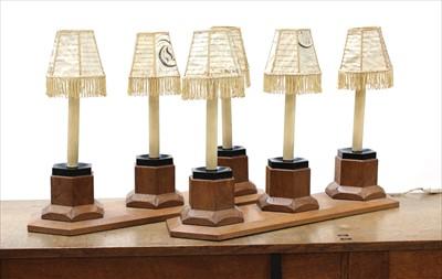 Lot 242 - A pair of oak three-light table lamps