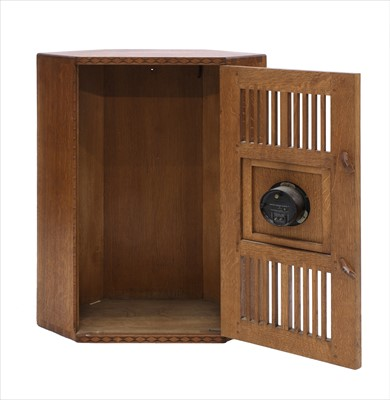 Lot 232 - An oak hanging corner cupboard