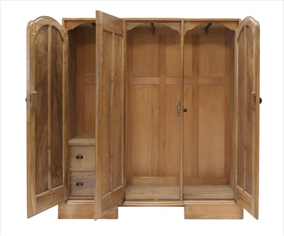 Lot 250 - A walnut triple wardrobe