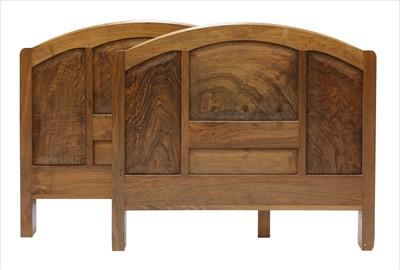 Lot 258 - A walnut headboard and footboard