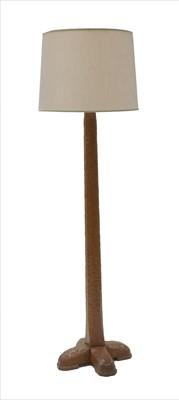 Lot 255 - An oak standard lamp