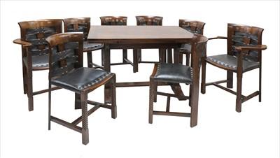 Lot 14 - An oak dining suite