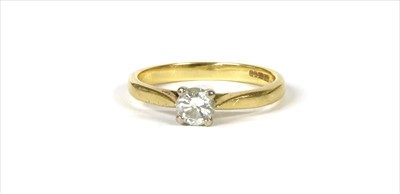 Lot 23-An 18ct gold single stone diamond ring