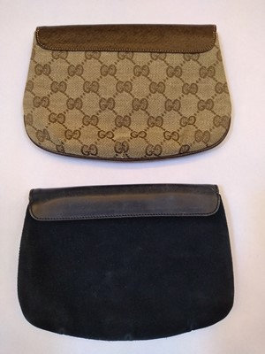Lot 1002-Two vintage Gucci clutch