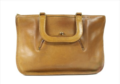 Lot 1020-A Coach tan leather tote bag