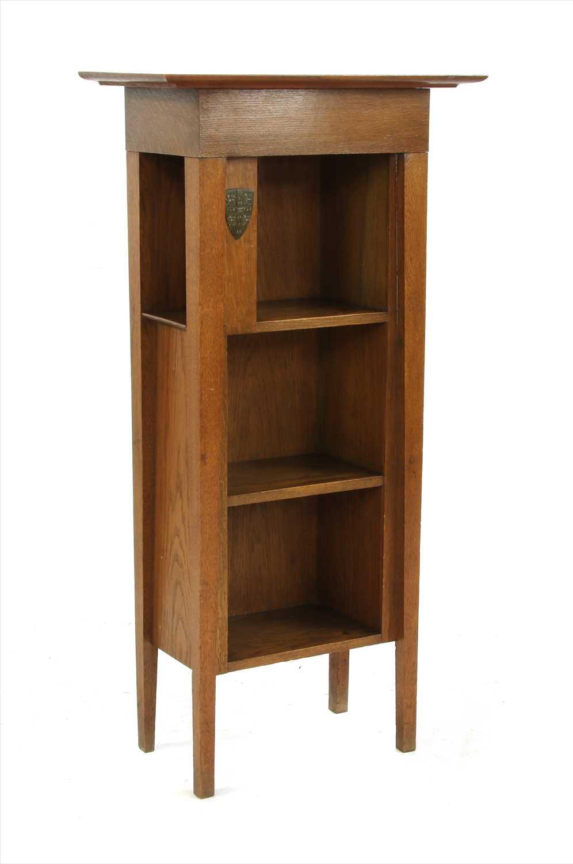 Lot 9-An oak University of Cambridge 'Encyclopedia Britannica' bookcase