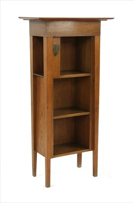 Lot 9-An oak University of Cambridge 'Encyclopedia Britannica' bookcase
