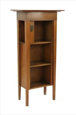 Lot 175 - An oak University of Cambridge 'Encyclopedia Britannica' bookcase