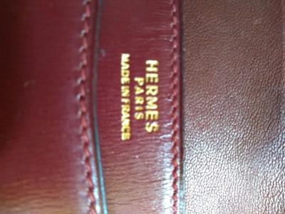 Lot 417 - An Hermès 'Lydie' red clutch bag