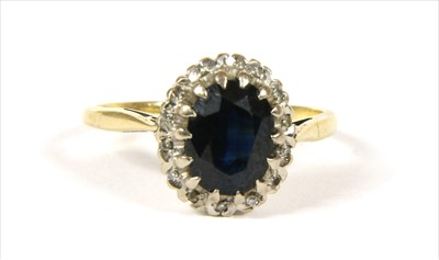 Lot 19-A gold sapphire and diamond cluster ring