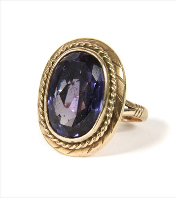 Lot 21-A gold synthetic colour change sapphire ring