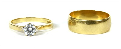 Lot 25-An 18ct gold D section wedding ring