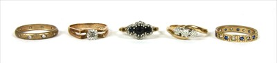 Lot 24-Five 9ct gold rings