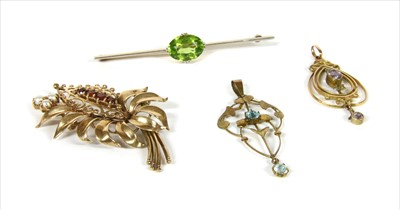 Lot 7-A gold peridot bar brooch