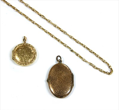 Lot 8-A 9ct gold circular locket