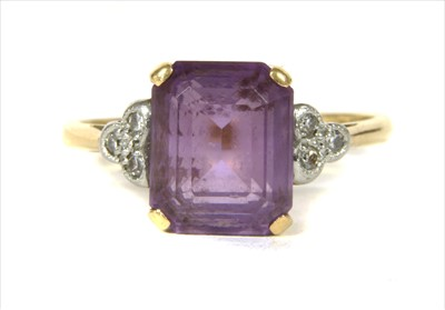 Lot 18-A gold amethyst and diamond ring