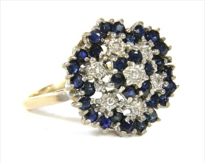 Lot 17-A 9ct gold diamond and sapphire four tier cluster ring