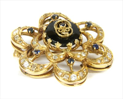 Lot 19-A gold sapphire, onyx and diamond brooch/pendant