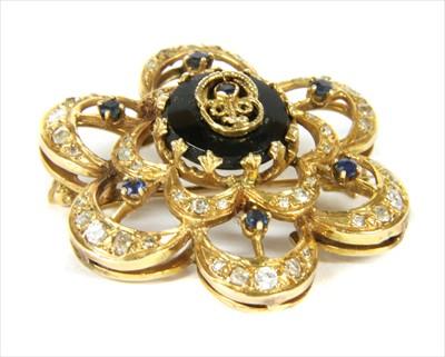 Lot 19-A gold sapphire, onyx and diamond brooch/pendant
