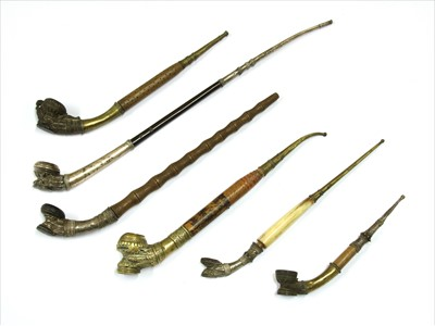 Lot 4-Six Burmese clay-mounted pipes