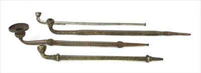 Lot 11 - Four Tibetan steel and metal pipes