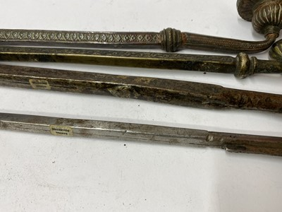 Lot 11-Four Tibetan steel and metal pipes