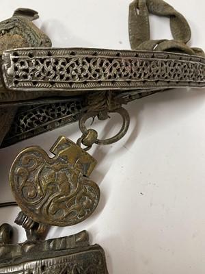 Lot 12-Three Tibetan leather tinder pouches or chuckmucks