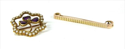 Lot 5-A Victorian gold diamond, amethyst and split pearl shamrock brooch