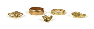 Lot 21-Four gold rings