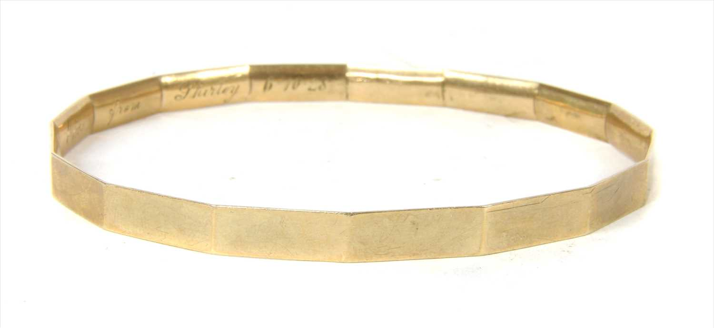 Lot 23-An Art Deco 9ct gold upper arm bangle