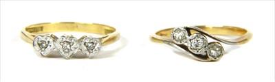 Lot 12-A gold three stone diamond ring