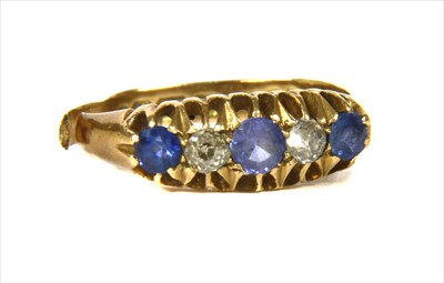 Lot 7-An 18ct gold five stone sapphire and diamond ring