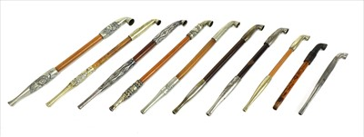Lot 20-A collection of ten Japanese kiseru tobacco pipes