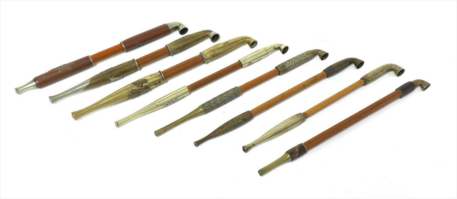 Lot 21-A collection of eight Japanese kiseru tobacco pipes